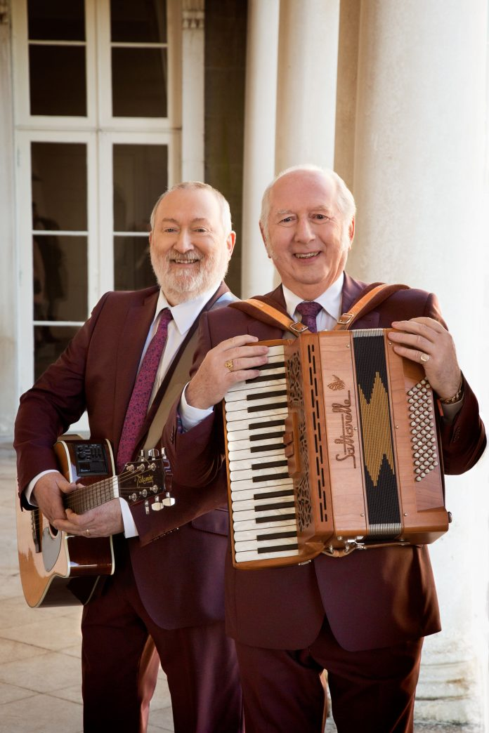 Foster & Allen with guitar and accordion.