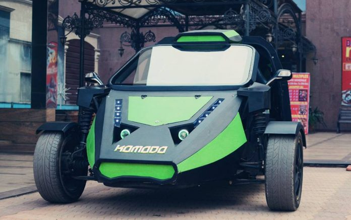 A black and green komodo electric car