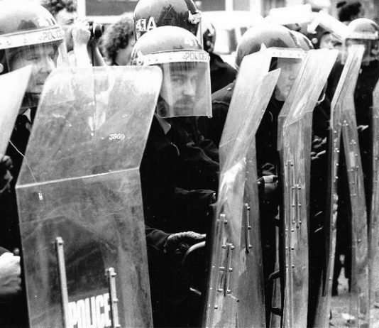 Riot police with shields during the miners' strike