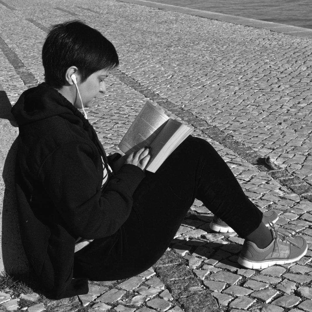 Person reading black and white