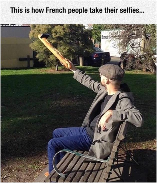 Man using baguette as a selfie stick