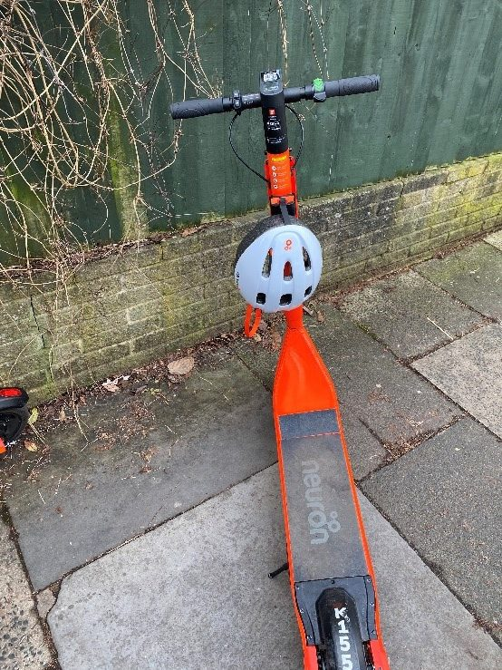 neuron e-scooters with helmet